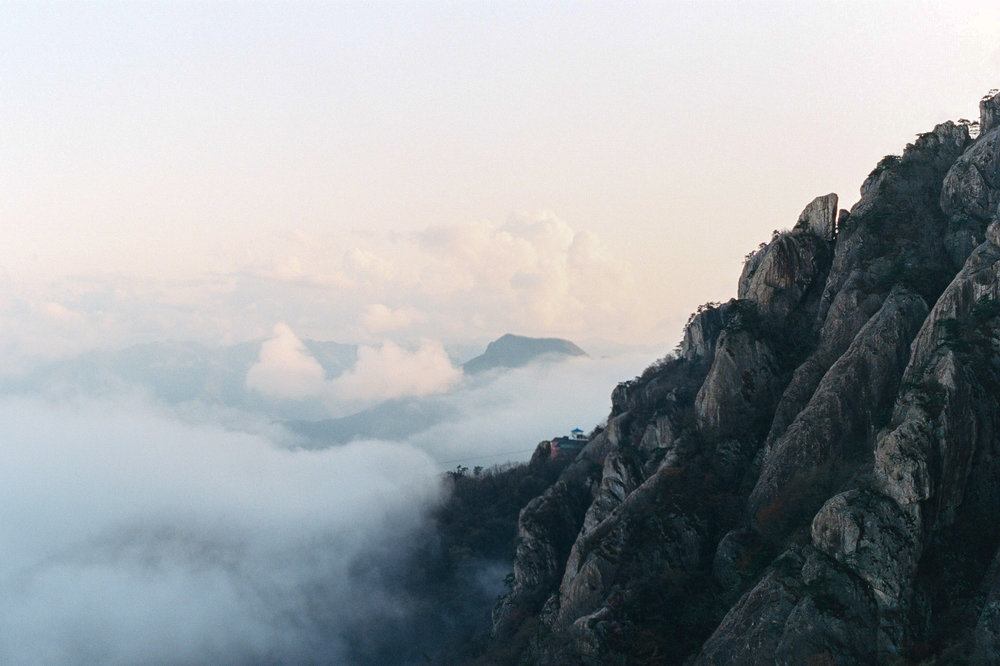A beautiful sunset on this mountain top reveals the beautiful clouds below.  This was shot on my Canon film camera in South Korea.