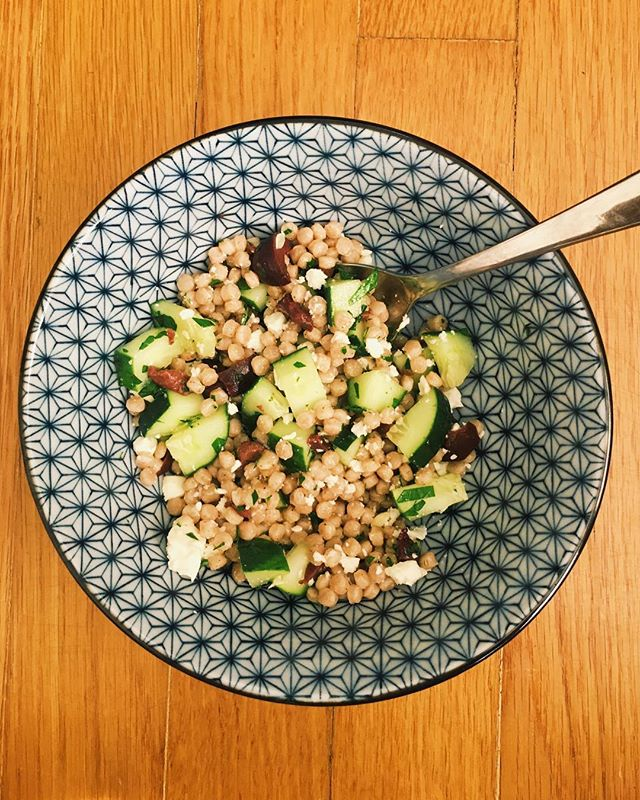 Yes, I ate my lunch on the floor because my workout kicked my booty. • • • Whole wheat couscous with cucumber, kalamata olives, feta, parsley, and lemon.