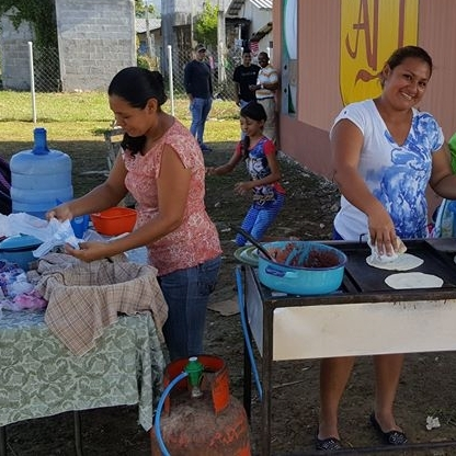 Some of the ladies from the church making tortillas before the service
