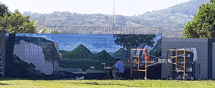 Al working on the mural
