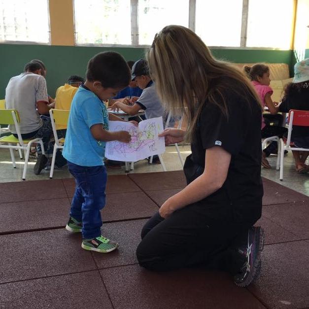 A team member helping a boy in children's church
