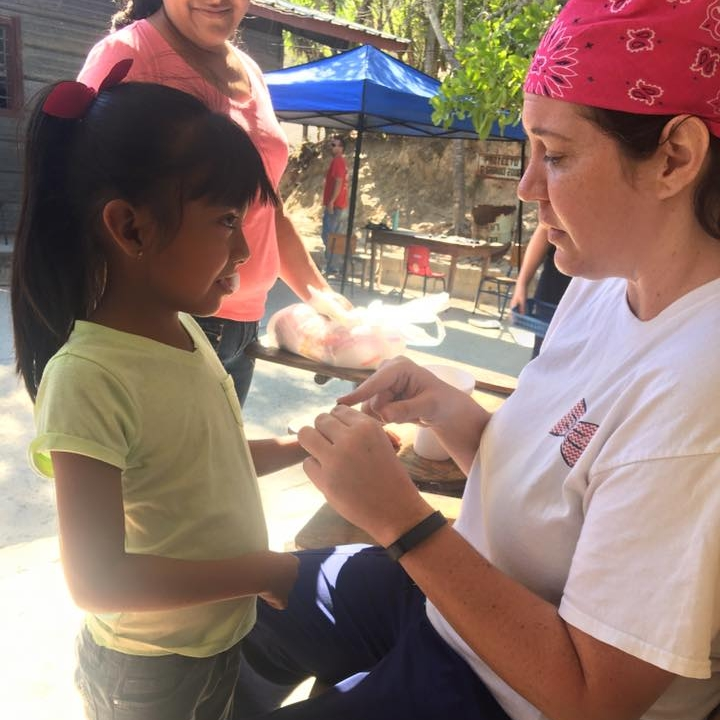 Team member playing with a child from San Marcos