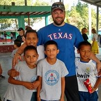 Team member and kids from a local school