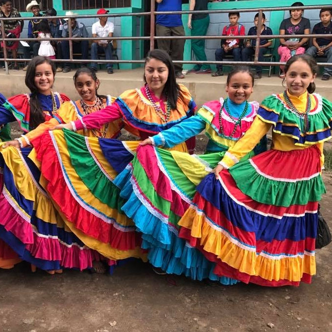 Girls from the community in traditional Honduran dresses