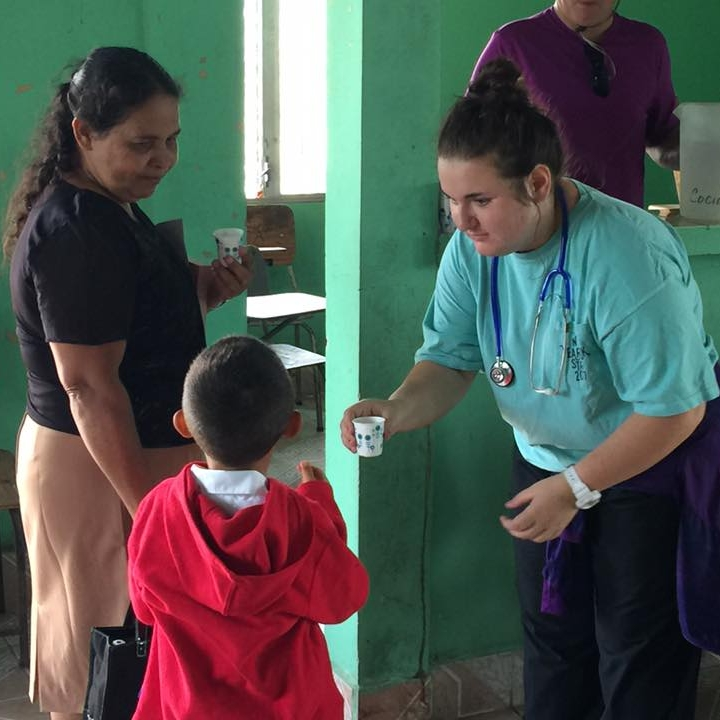 Boy receiving his anti-parasite medication