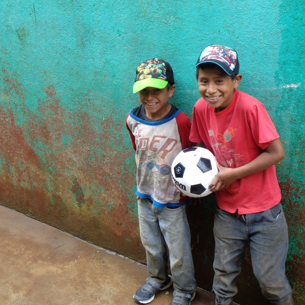 Two boys excited about their new soccer ball