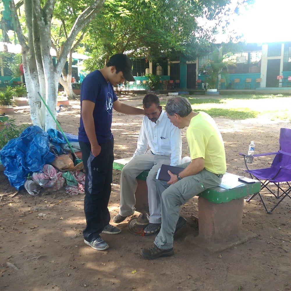 Praying with a patient in the one-on-one evangelism