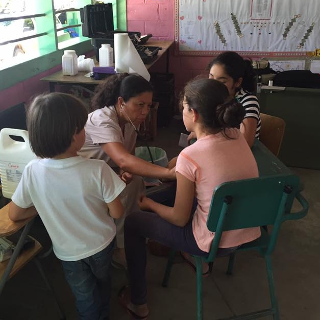 Dr. Delia examining a patient