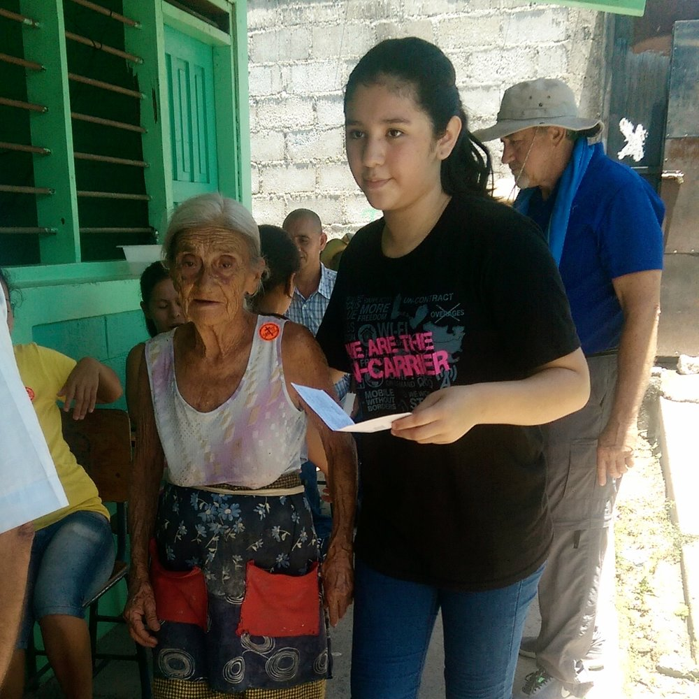 Helping an elderly woman to a medical station
