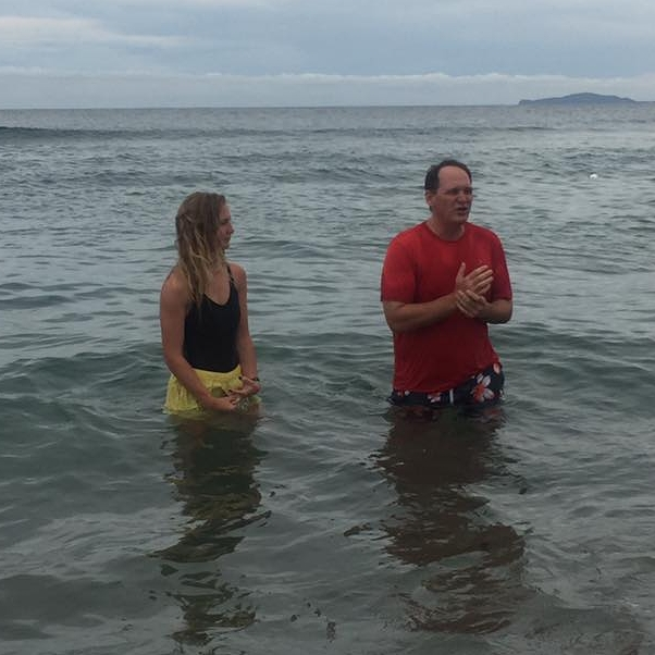 One of the team members getting baptized in the Carribean Sea