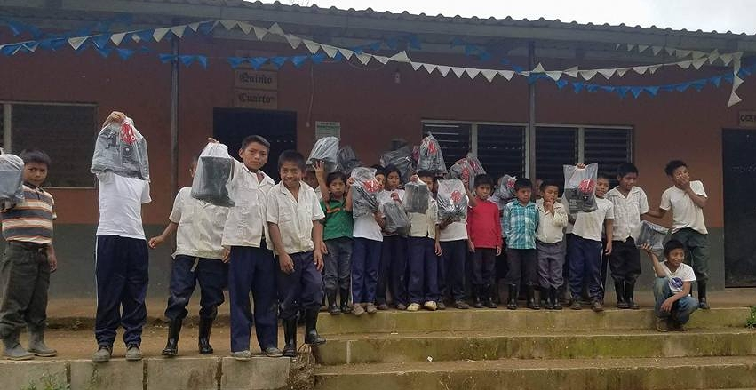 Some of the children at the local school after receiving their rain boots!
