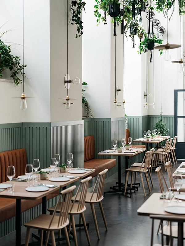 Soft blues of Portuguese tiles casually accompanying the industrial foundation of what once was a can fabrication plant. Together with warm leather and wooden tables framed by wild plants, the location makes a cool venue for your everyday food experience.