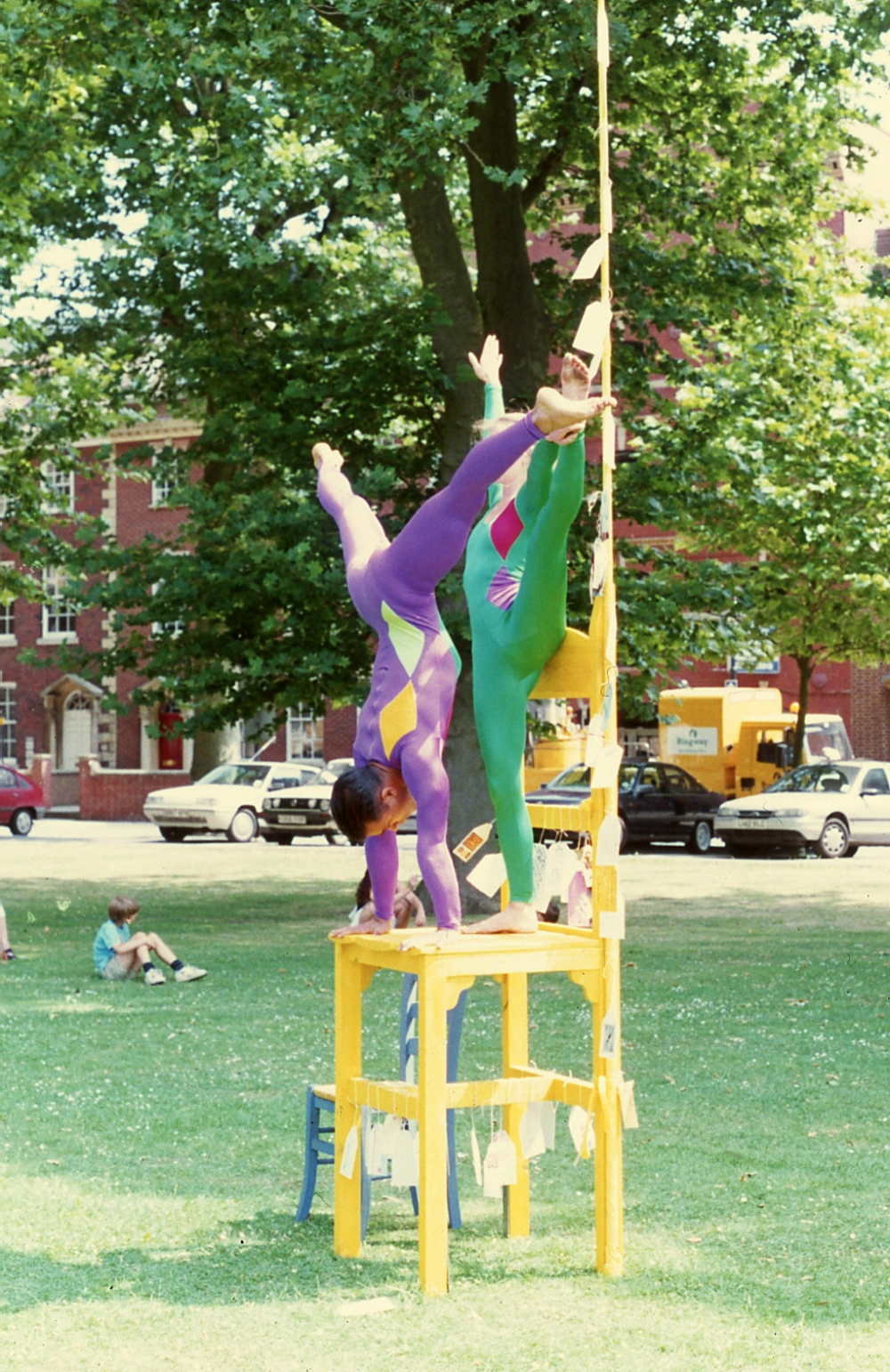 Large Yellow Chair With Acrobats