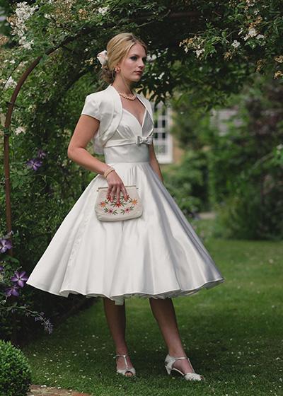 Tilly  -Tea length Italian silk, princess neckline has under-bust band with a pretty central bow