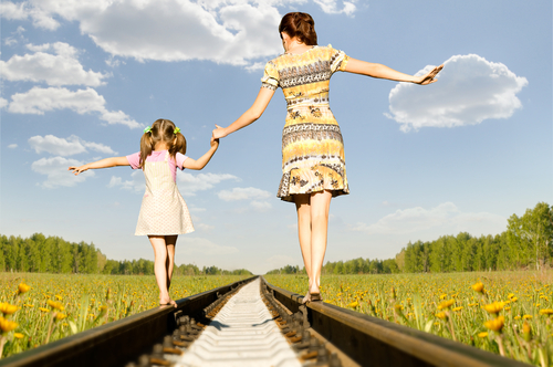 Image: Mom and Daughter Walking on Train Tracks