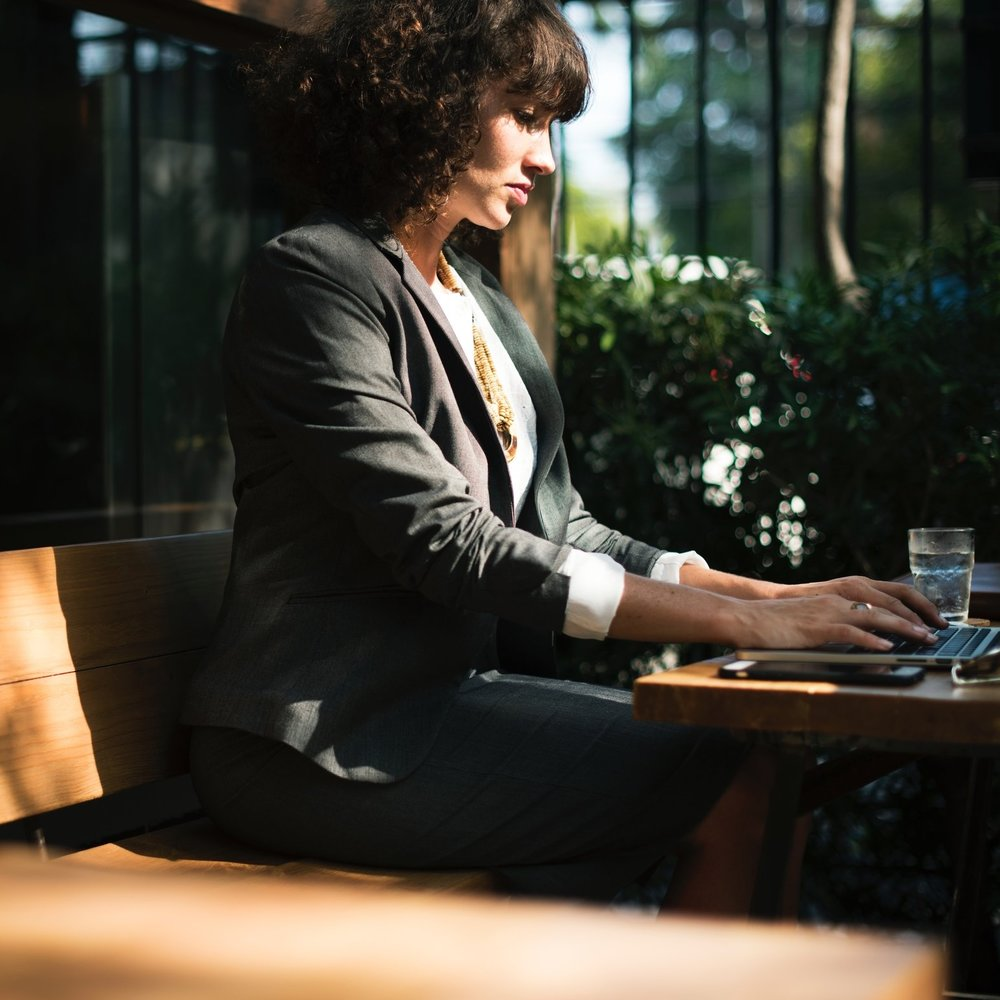 businesswoman at table.jpg