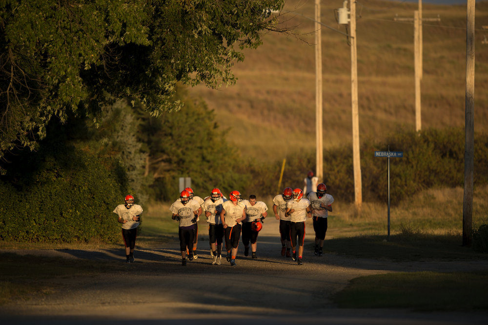 At 1 square mile, Cody is the biggest town in Nebraska's Cherry County. It takes the football players six minutes to run from the practice field, down Main Street and up the hill to the field, which is located on the other side of town.