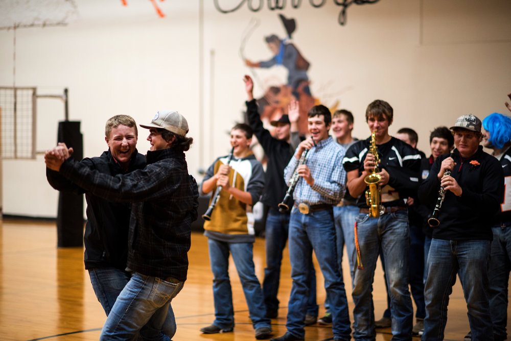 "During the pep rally, football players are divided into groups, and each group draws the name of a song from a hat and puts on a skit to the song. Here, players perform ""My Heart Will Go On"" by Celine Dion."