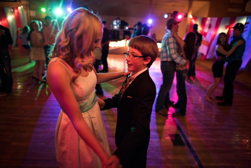 Cody residents transformed the town's civic center -- itself housed in a transformed shed -- for the school's homecoming dance. Here, senior True Ford dances with freshman Isaac Cook, the youngest kid at the dance.