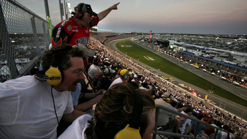 Fans in the grandstand cheer as Ryan Newman crosses the finish line, winning the 50th running of the Daytona 500.