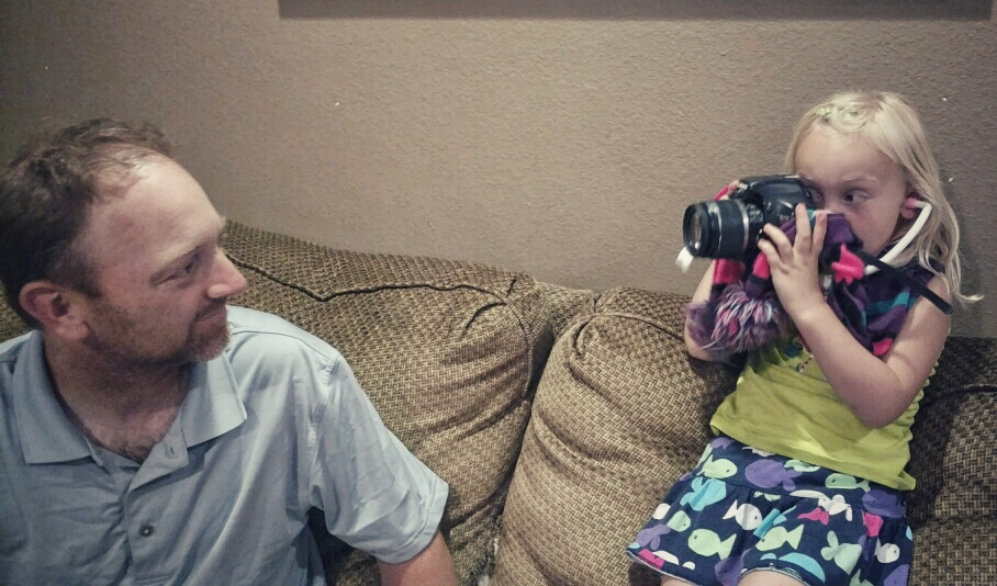"Emorie' mom sent this picture of her ""interviewing"" her dad, Jarod, with her stethoscope and her mom's DSLR."