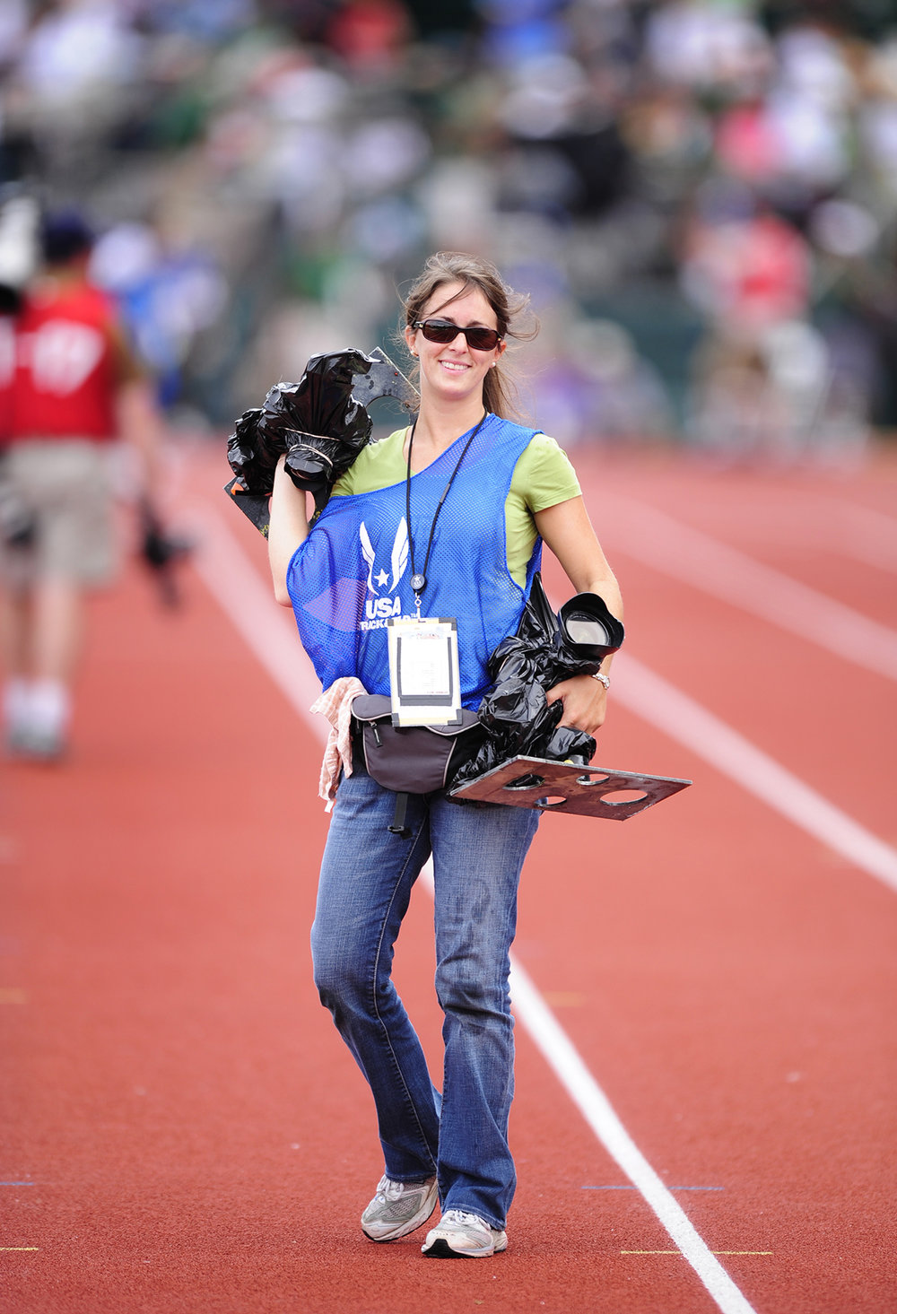Carrying remotes back to our staging area after the Steeplechase, hence the trash bags which are the easiest and cheapest way to keep cameras dry during tracks wettest event.