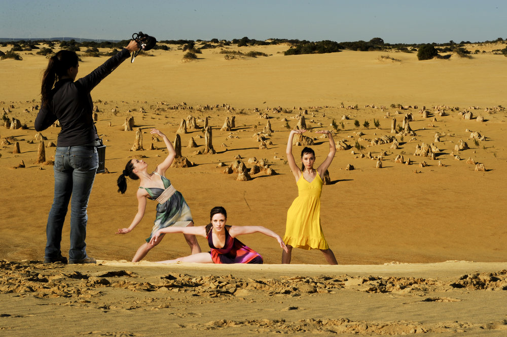 Standing in as a human light stand on a sand dune with the Pinnacles in the background.