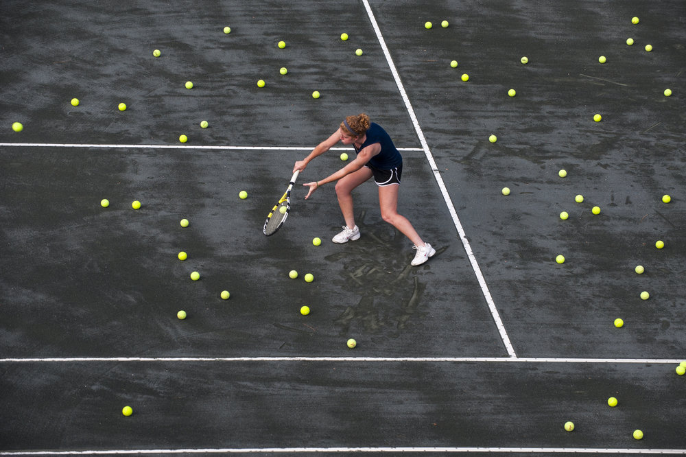 Disclaimer: never play tennis on a court with this many loose balls. You will sprain and ankle. For this shot we spread tennis balls all around the court and had Sierra stay in the same position for each shot. Though the balls aren't a realistic representation of a tennis practice, they are graphically pleasing.