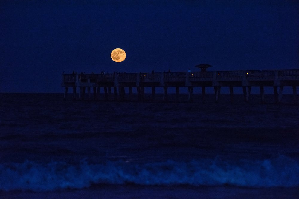 The moon rise over the Jacksonville Beach Pier.