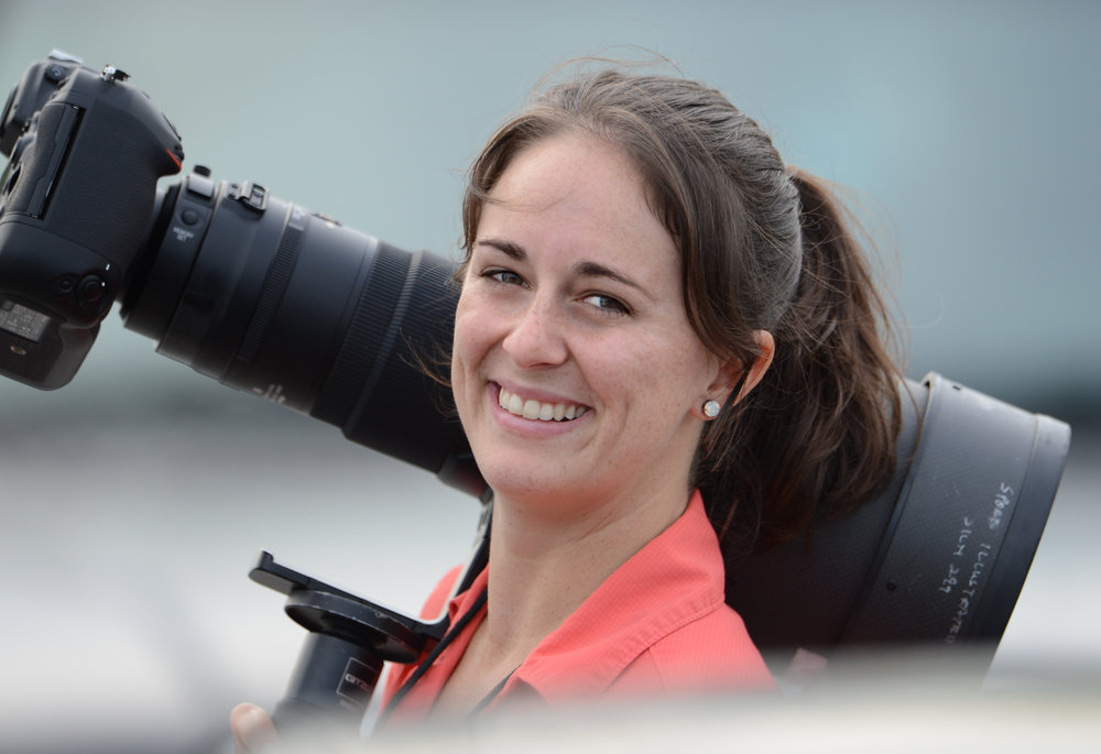 Carrying a Nikon 400mm while on assignment in Plantation, FL, in 2012.