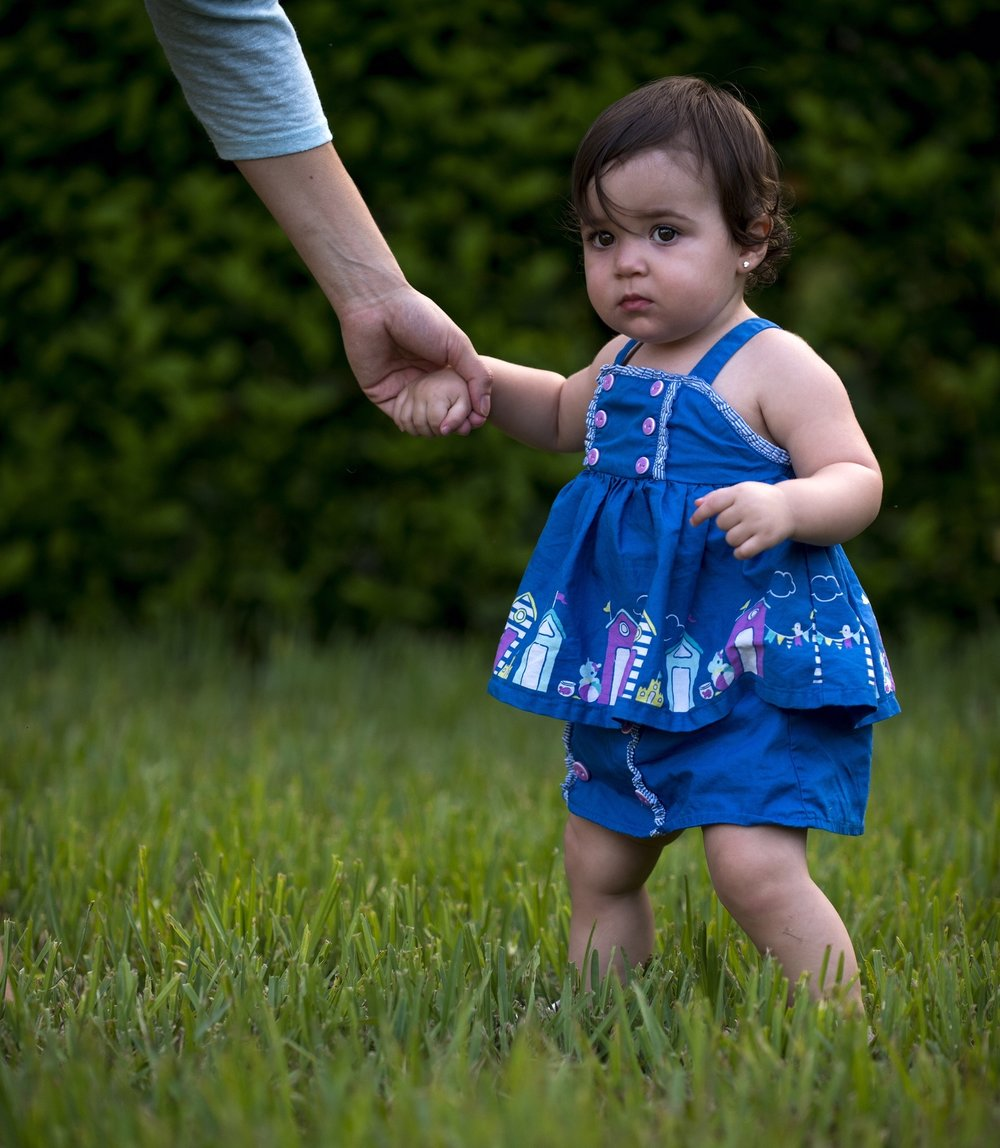 Sofia holding her dad's hand to walk at 12 months old. In three and half years I have watched Adam and Irina raise a strong, stubborn and hilarious little woman. She reminds me very much of her mother.