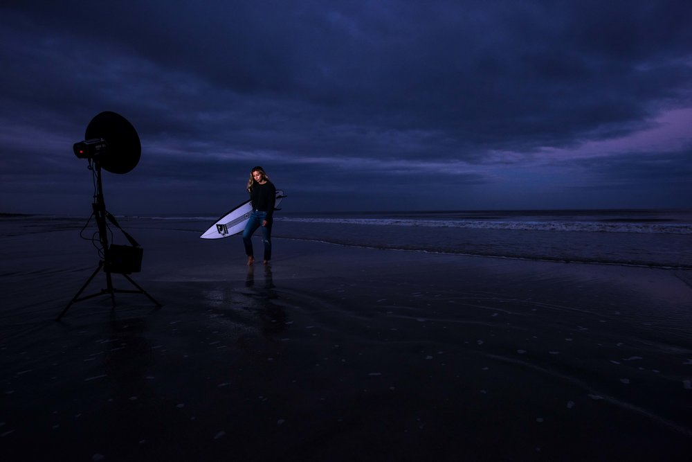 Molly on the beach with a Hensel Expert D 500, a Power Max L battery pack, and a beauty dish lighting her in the dusk light.