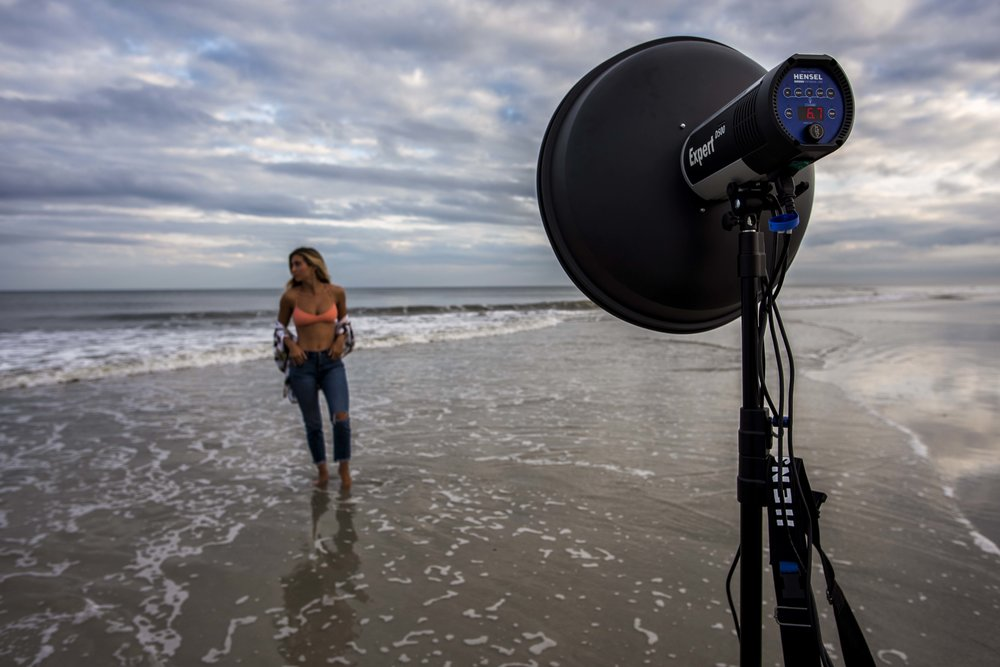 @Mollykirky posing in Atlantic Beach, FL, lit by a Hensel Expert D 500 and beauty dish that is being powered by a Power Max L battery pack.