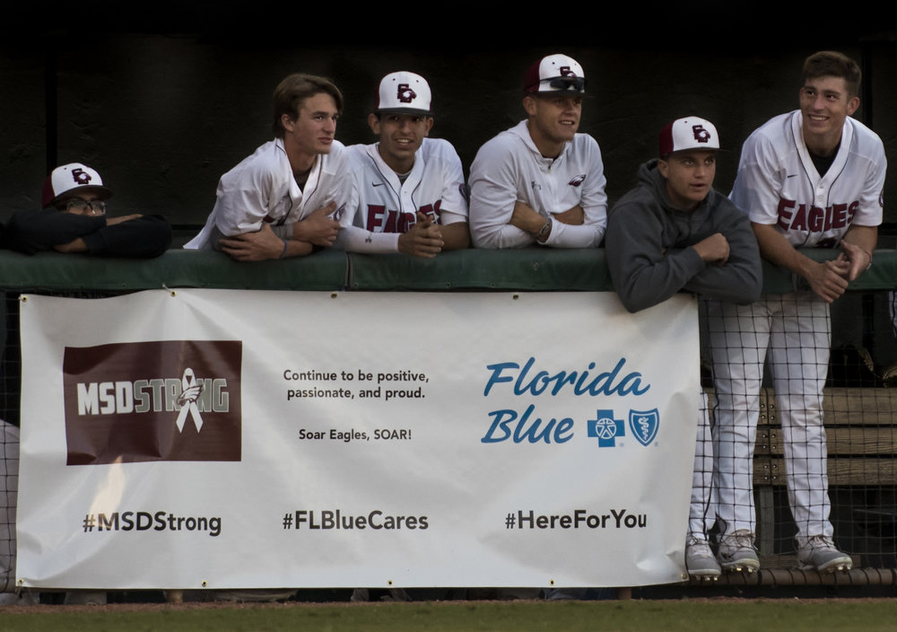 MSD teammates laugh together in the dugout.