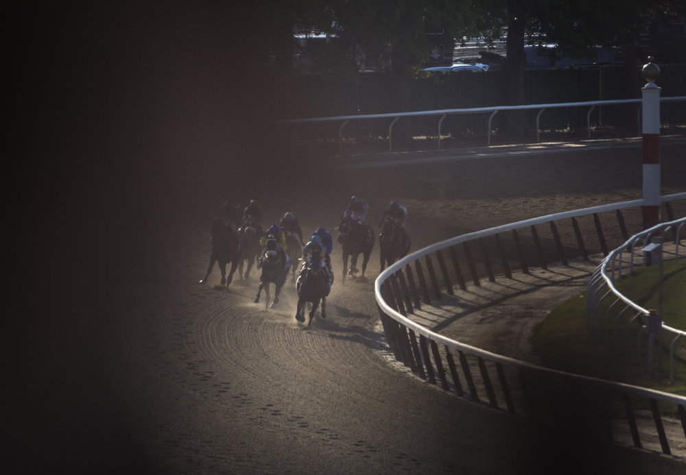 My view through my 600mm f/4 Nikkor lens. I was blocked almost entirely as American Pharoah made his way around the fourth turn.