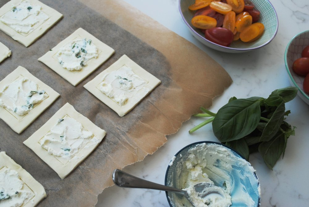spread a little cream cheese mixture on each square inside the border