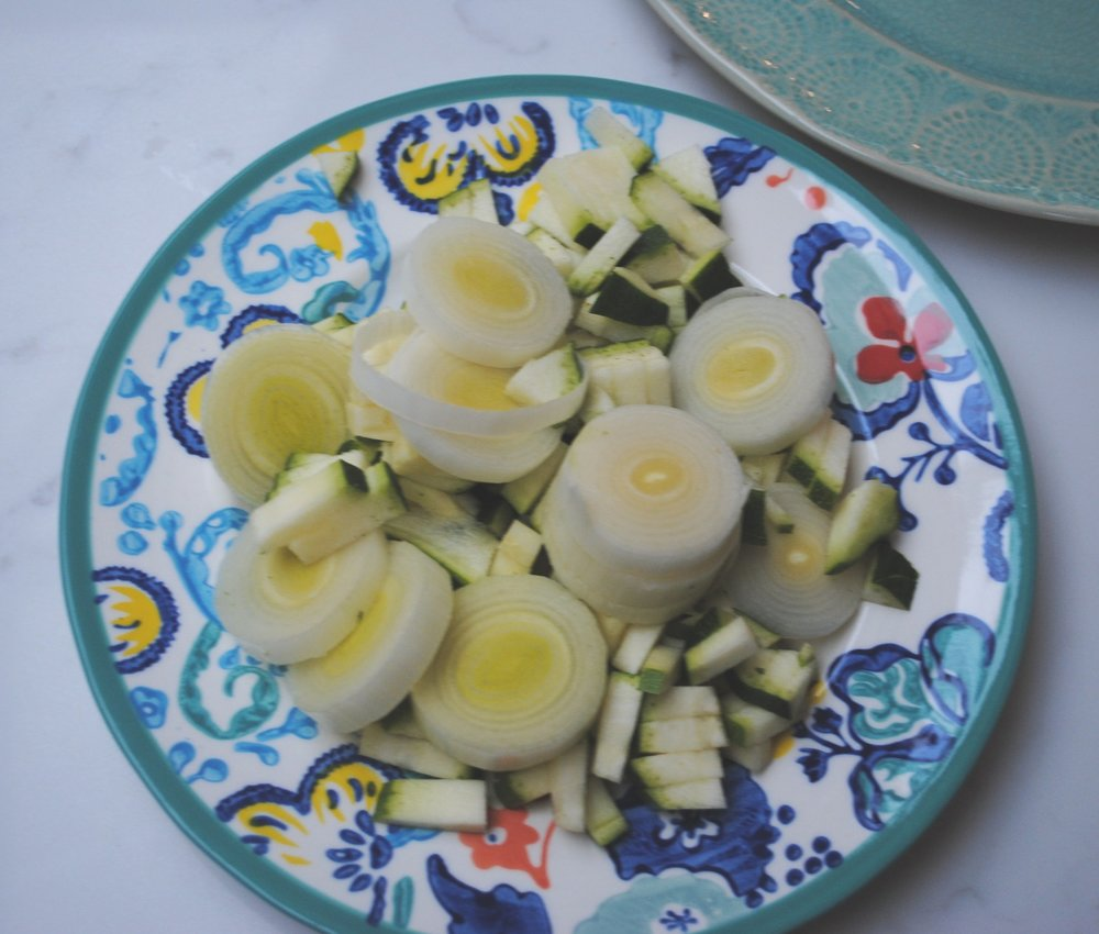 Sautee the vegetables and then mix in the cream cheese