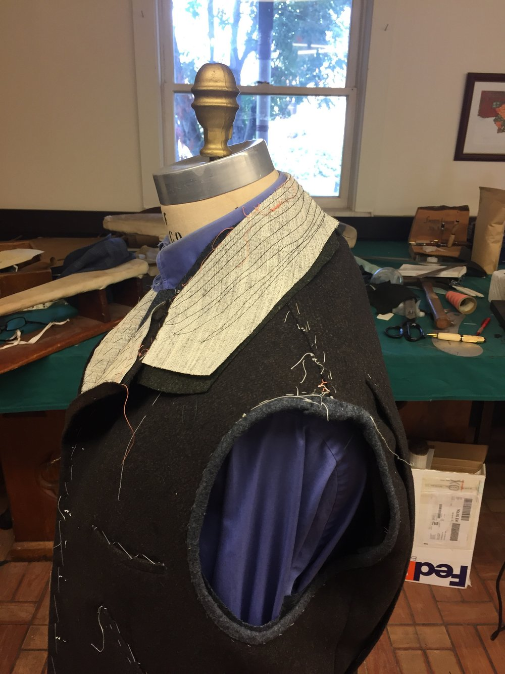 The collar has a 2 inch collar stand to be high on the neck. And when the collar is turned up it is very warm and practical.