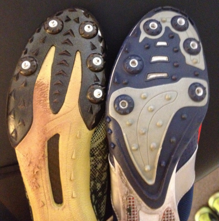 "Some stuff you need to know about running spikes.  I see many track runners in my office, from middle school all the way into the USA Masters Division.  A few years ago one of the top USA Masters Milers came to see me on Friday before heading off to a national meet. He showed me some of his spikes (see pics above) and complained the there was something off on the spikes on the left, the Nike Mambas.  The shoe to the right is the Nike Zoom Miler.   You need to understand a bit of the physics of running turns to understand what is missing for this runner in this pair of spikes.  Things do change if you are running on a sloped track, but those are only found indoors and are not all that common to run on for most folks so we will stick with the thinking on flat tracks.  What you should be able to easily detect is that the Nike Mamba's are missing the lateral 5th metatarsal forefoot spike on the cleat plate.  And you need to then realize that this is the right shoe, so it is the outside foot/leg on the track. It is the foot that will be pushing off harder from the outside on the turns to keep the centripetal forces of running a curve from allowing the runner to fall off the curve into the outer lanes. This right foot will always be pushing from outside to inside to maintain the body's progression in the desired lane, when running the curves.  Think about it for a minute. In order to run in a circle, or a curve in this situation, the outside foot always has the tendancy to be more inverted to keep foot contact on the ground. This is where a Forefoot varus MIGHT come in handy ! This means the foot will be tipped to the outside a little, because of the curve and because the body will be leaning into the center of the track on the curves. Thus the foot and shoe will be relying on more lateral foot pressures to drive the body mass back into the lane since centripetal forces will always be driving you laterally out of the lane.  Thus, the lateral spikes on the right foot must be accommodating.  In the case of the Mamba shoe. there is only a sheet of black hard plastic over the midshaft-head of the 5th Metatarsal on the lateral foot. It is no wonder the runner was feeling like he was slipping on the turns (the front of the midfoot was not anchored to the ground, only the forefoot due to the spikes in that location). You can see clear evidence of the lateral slipping in the picture. Can you see the orange/brown patch where he was slipping ? A spike there in that area would have been wonderful.  Slipping is a power leak and a risk for injury.  If the foot is trying to gain purchase into/onto the track with the foot inverted there needs to be traction at that lateral foot, what is referred to as the Lateral Column.  You can see why the Nike Zoom Miler was a better choice, there is a nice spike placement under the lateral foot for just this measure, and there is no evidence of slippage wear.  He told me that the Mamba was a steeplechase designed shoe but we still both felt that the issue remained relevant even in that event. The Nike website however states that ""the Nike Zoom Mamba Men's Track and Field Shoe is perfect for the 800-5000m track athlete"" so we think they have missed an issue here in our opinion.  I could make a better case for the Mambas if  they were for a 100m straight run but I would still like a 5th metatarsal /lateral spike where there isn't one.  I will occasionally file spikes to get the perfect feel for the athlete.  It is usually the 5th metatarsal and 1st metatarsal spikes I mess with, merely to help hone the athletes feel on the track. The problem is that each track has a different feel so it is less of an occurrence in recent years.  It is good to know your shoes, it is good to know your physics. It is great to know them both and melt them together to solve problems.  Not all spikes are created equal, not all tracks are the same, not all events are the same and certainly not all feet and the athlete's who own them are the same.  And on the topic of Forefoot Foot types, both the forefoot varus and forefoot valgus foot might have a problem with the Mamba's depending on their strength, skill and strategies for ground purchase.  Hopefully your shoe store and your track and cross country coaches know these issues. You might want to bring this blog post to their attention however, just in case.   Dr. Shawn Allen"