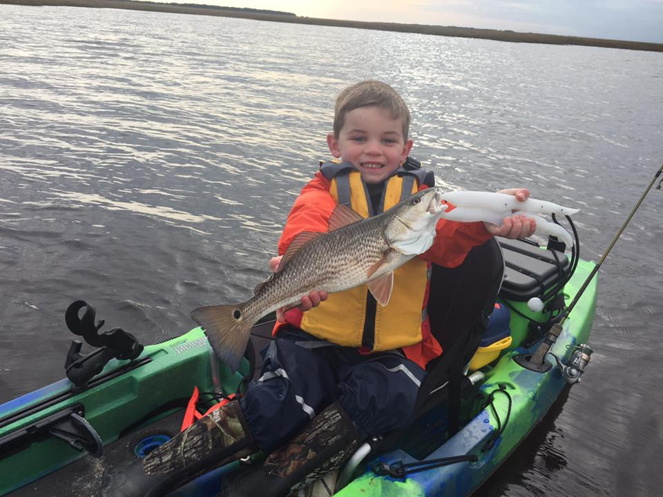 Bryson Tetter (Ethan's Nephew) showing off a nice Red Drum caught fishing with the Pogie's Crew!