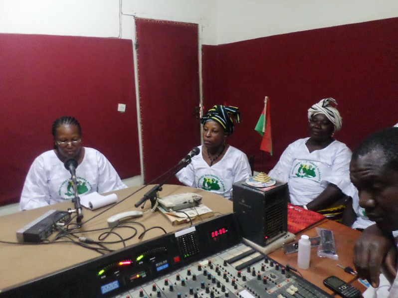 We Are the Solution members at a radio station in Burkina Faso advocating for market access