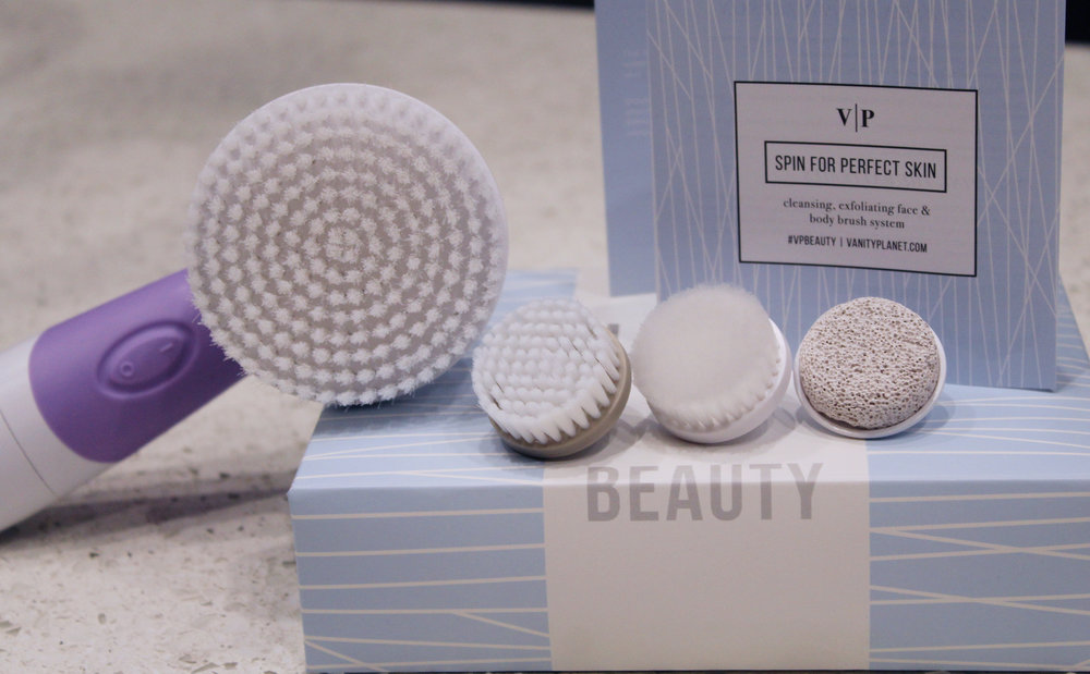 Includes: daily cleansing facial brush, exfoliating facial brush, body brush, pumice stone and water-resistant handle  Colors: lavender, frosted blue, lucite green, midnight black, sandstone and strawberry ice