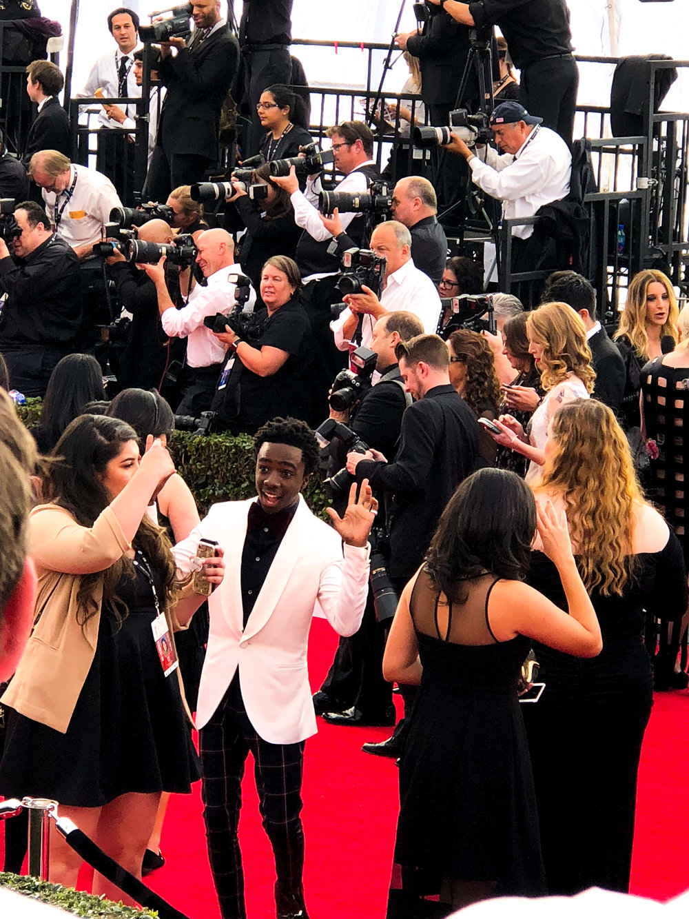 Caleb McLaughlin Having Fun With the Crowd - wearing Louis Vuitton (jacket), Antonio Marras (pants)