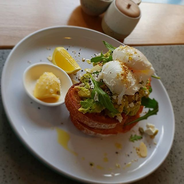 Poached Eggs, Avocado & Feta Smashed on Crispy Sourdough Bread...with Salted Butter & Almond Flakes! #longstreetcoffee #richmond