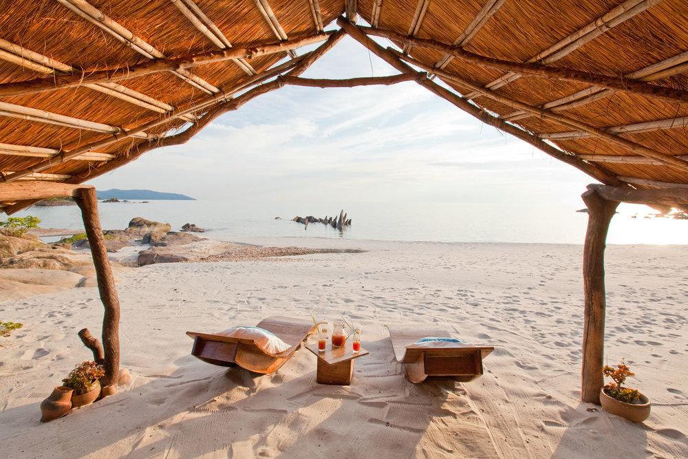 Daybed sur plage Manda Wilderness