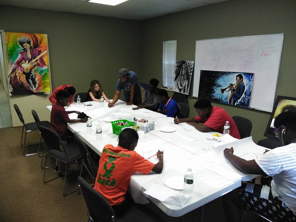 Volunteer ART instructor leads an art project at TMC!