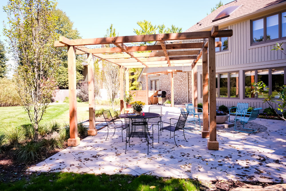 This backyard makeover in Carmel, IN features a pergola, fire pit, custom coverings, hot tub and more. (Photo by Lauri B. Adams)