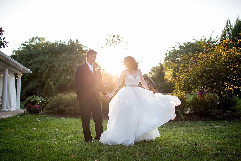 bride and groom on grass at sunset 2000px.jpg