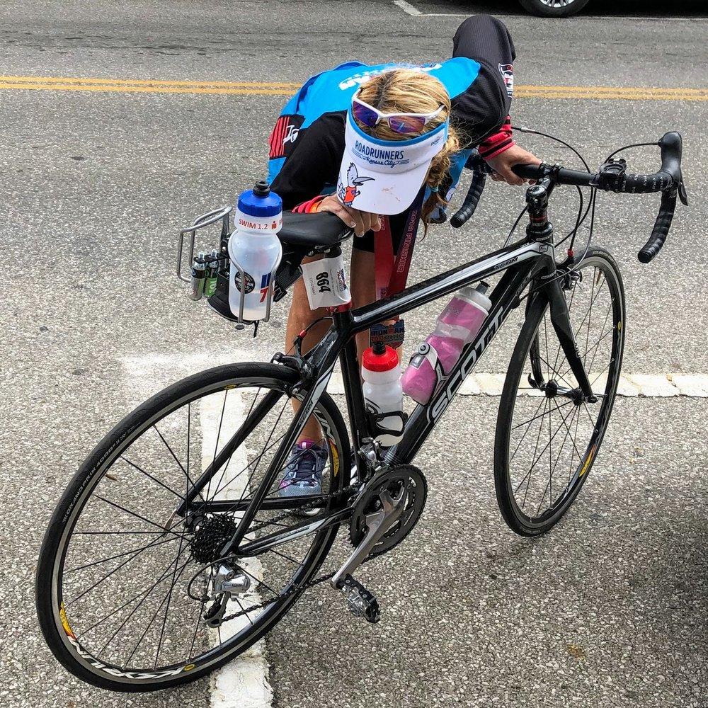Coach Amy embraces Scarlett after a successful bike leg at Ironman 70.3 Ohio.