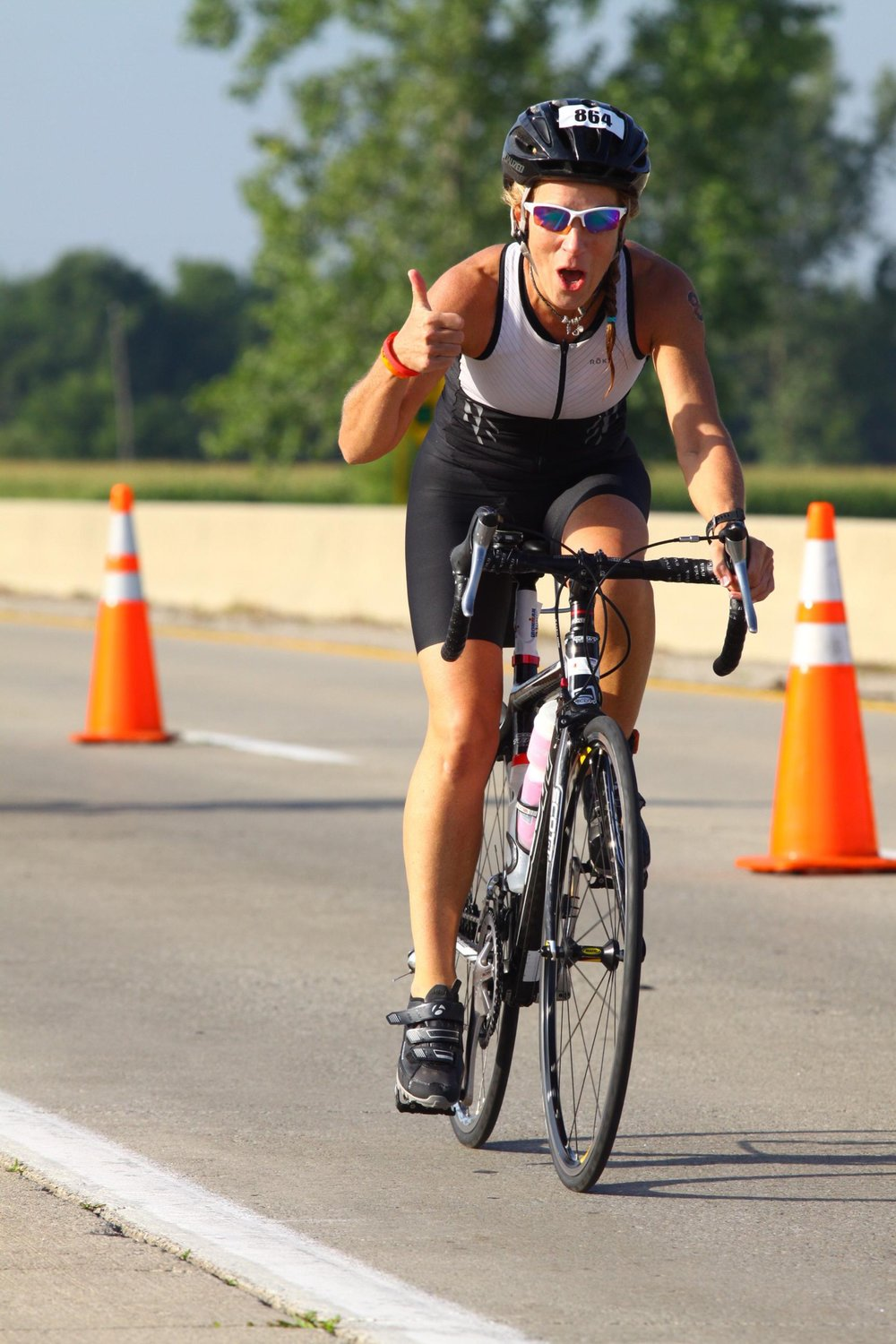 Ironman 70.3 - Ohio. Coach Amy has fun with the professional photographers on the bike course.
